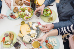 "Image from the leaflet ""Milk - everything you need"", produced by British Dairying, of people eating from a cheese platter"