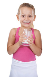 "Image from the leaflet ""Milk - everything you need"", produced by British Dairying, of a young girl drinking milk"